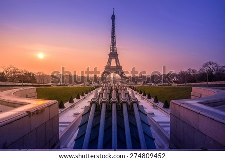 Eiffel Tower and fountain at Jardins du Trocadero at sunrise, Paris, France - stock photo