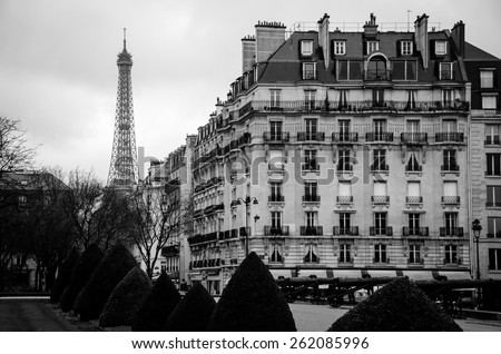 Eiffel tower and Paris apartment buildings - stock photo