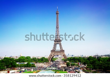 Eiffel Tower and Paris skyline in summer sunny day, France, retro toned - stock photo