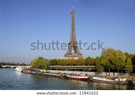 Eiffel tower and quay Seine river - stock photo
