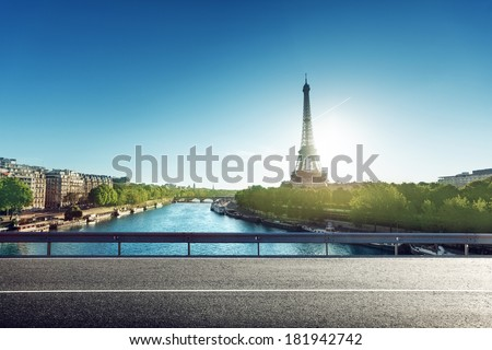 Eiffel Tower and road in sunrise time - stock photo
