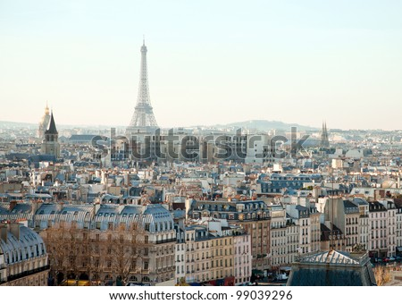 Eiffel Tower and roofs of Paris - stock photo