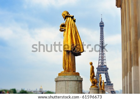Eiffel tower and statue on Trocadero.Photo with tilt-shift effect - stock photo