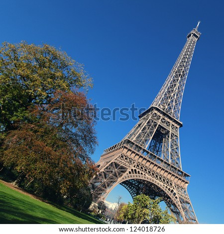 Eiffel Tower and trees in Paris in autumn - stock photo