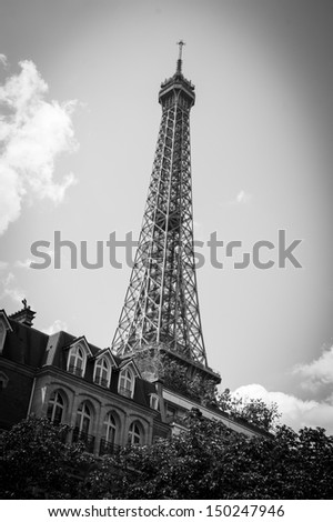 Eiffel tower and typical parisian house with mansards. Black and white. Shadowed angles. - stock photo