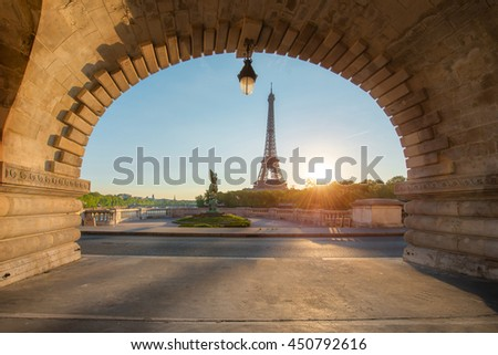 Eiffel tower at Paris from the river Seine in morning. Paris, France. Eiffel Tower is iron lattice tower on the Champ de Mars in Paris, France. - stock photo