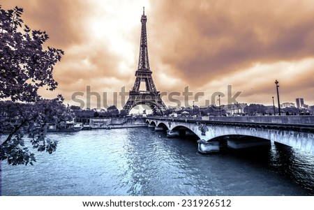 Eiffel Tower from Seine. Winter rainy day in Paris - stock photo