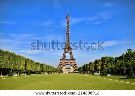 Eiffel Tower, iconic Paris landmark with vibrant blue sky - stock photo