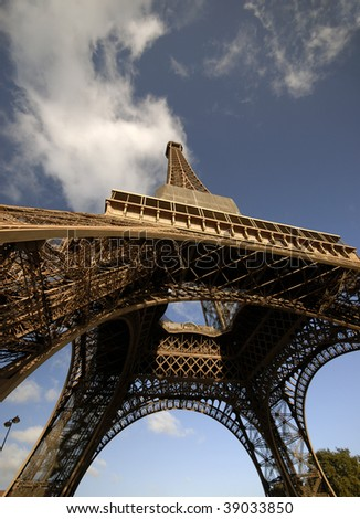 Eiffel Tower in a wide angle view from below. - stock photo