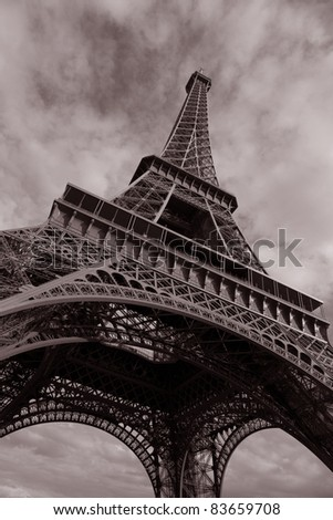 Eiffel Tower in Black and White Sepia Tone against clouded sky; Paris; France
