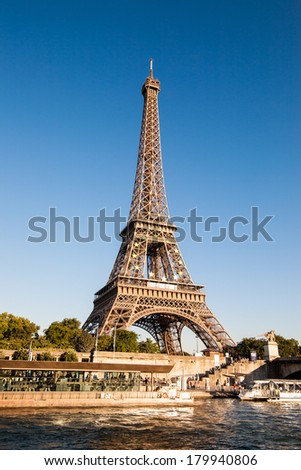 Eiffel Tower in Paris France on a clear day. Emblem of the EU in the Eiffel Tower./Emblem of the EU in the Eiffel Tower/Emblem of the EU in the Eiffel Tower - stock photo