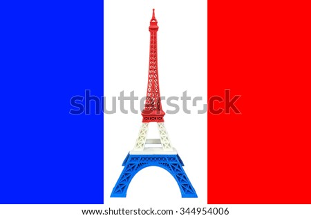 Eiffel Tower Model with Red White Blue Stripe printed by 3D Printer on France Flag, Pray for Paris Concept. Creative Model Toys or Souvenir Objects from Paris, France on The France Flag. - stock photo