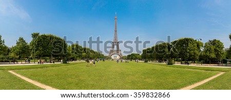 Eiffel Tower most visited monument in France and the most famous symbol of Paris in a summer day - stock photo