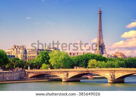 Eiffel tower rising over Seine river on sunset, Paris, France