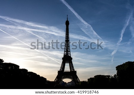Eiffel Tower silhouette and plans tracks at sunset. Paris, France - 26/NOV/2015 - stock photo