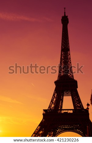 Eiffel Tower silhouette at sunset in Paris France - stock photo