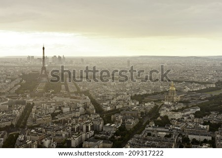 Eiffel tower (Tour Eiffel) in Paris at atmospheric and gloomy dusk in summer - stock photo