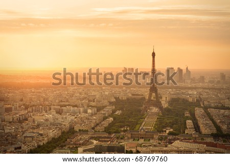 Eiffel tower (Tour Eiffel) in Paris at sunset - stock photo