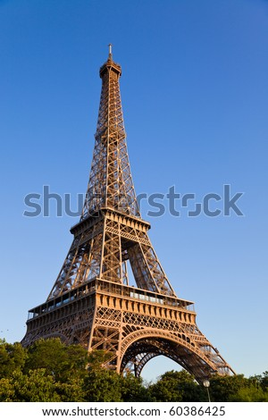 Eiffel tower under last sunlight. Vertical wide angle. France - stock photo