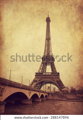 Eiffel tower view from Seine river, Paris, France.  Photo in  grunge and retro style.  Added paper texture - stock photo