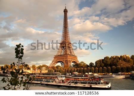 Eiffel Tower with boat in Paris, France - stock photo