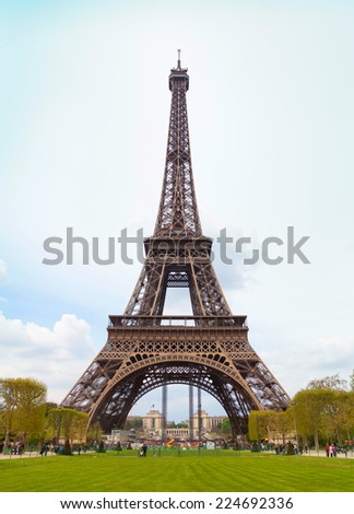 Eiffel Tower with cloudy sky in winter, Paris, France. - stock photo