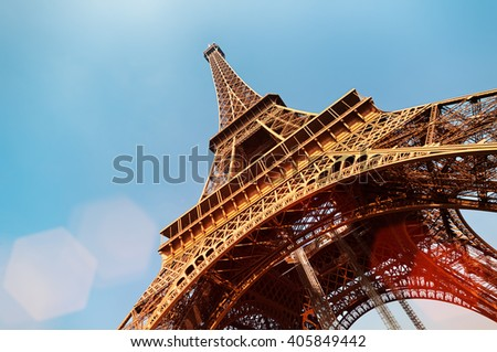 Eiffel Tower with lens flare and copy space.