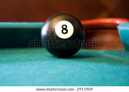 Eight Ball on a Green Felt Billiards Table - stock photo