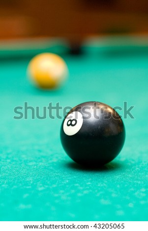Eight ball on a pool table - stock photo