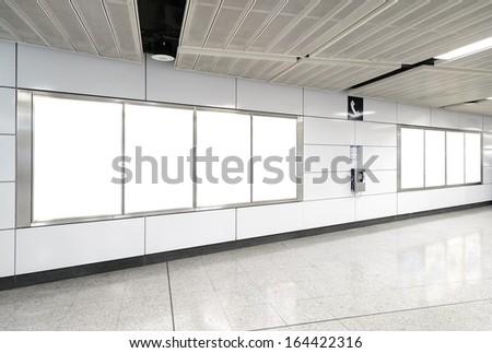 Eight big vertical / portrait orientation blank billboard in public transport - stock photo