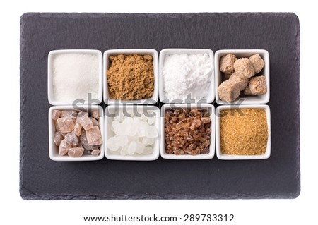 Eight bowls of various on natural slate serving tray isolated - stock photo