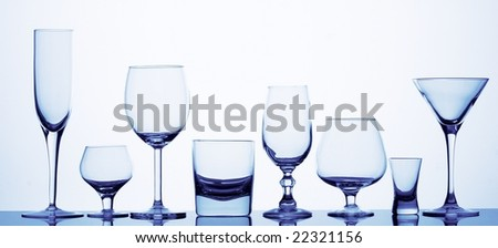 Eight different glasses in blue - stock photo