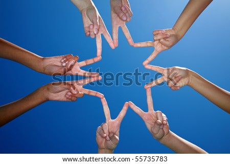 Eight hands form a star with their fingers - stock photo