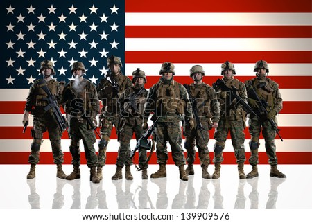 Eight isolated U.S. Marines. on the smooth floor. Soldiers against the background of the American/USA flag. - stock photo