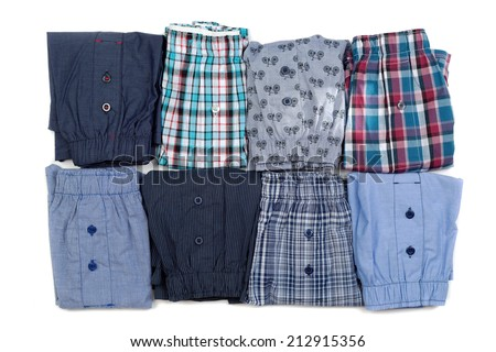 Eight men's briefs folded. Isolate on white. - stock photo