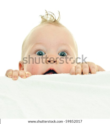 eight month baby clambers on white surface - stock photo