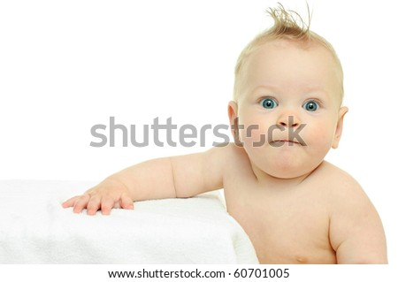 eight month baby leans his hands against white surface - stock photo