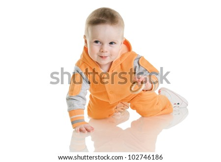 eight month baby sits on white background - stock photo