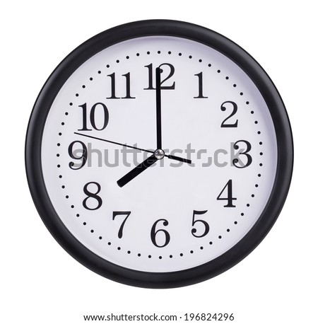 Eight o'clock on the dial round clock - stock photo