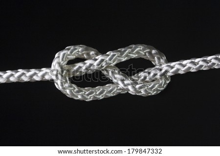 eight rope knot isolated on black - stock photo