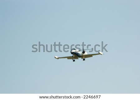 Eight seat, dual engine private jet comes in for a landing - stock photo