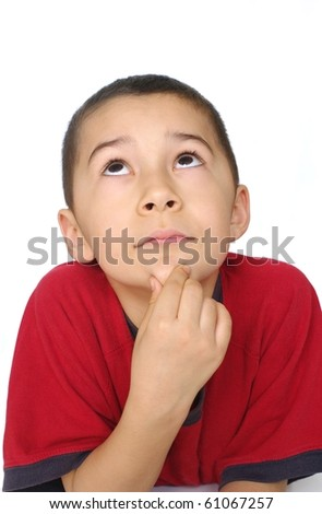 Eight-year-old boy looking up and thinking, isolated on pure white background - stock photo
