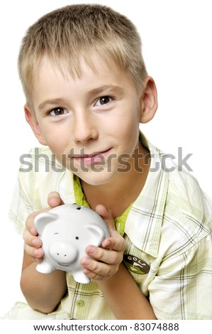 eight years old boy with big piggy bank isolated on white - stock photo