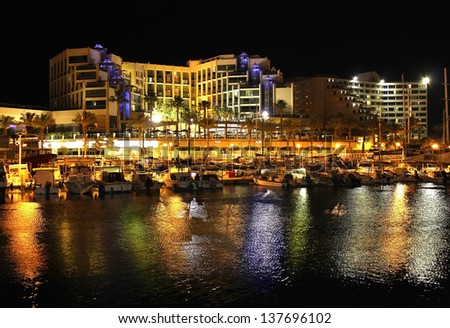 EILAT, ISRAEL - APR. 12: night view on  marina and moored yachts and boats and modern hotels in popular resort  - Eilat of Israel on April 12, 2013 Eilat, Israel