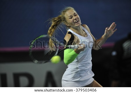 EILAT, ISRAEL - FEBRUARY 06, 2016: Professional tennis player Julia Glushko from Israeli national team in action during the BNP Paribas FedCup game 2016 at ?Eilat Tennis Center in Israel