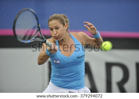 EILAT, ISRAEL - FEBRUARY 05, 2016: Professional tennis player Shachar Peer from Israeli national team in action during the BNP Paribas FedCup game 2016 at Eilat Tennis Center in Israel