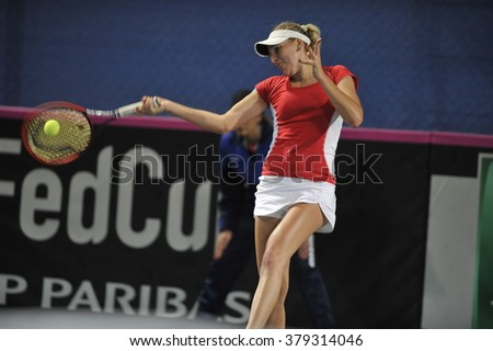 EILAT, ISRAEL - FEBRUARY 05, 2016: Professional tennis player Tena Lukas from Croatian national team in action during the BNP Paribas FedCup game 2016 at Eilat Tennis Center in Israel