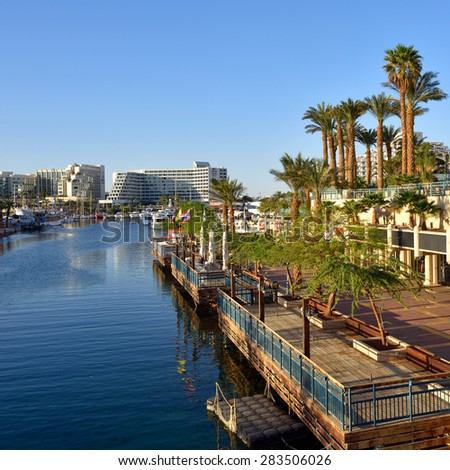 EILAT, ISRAEL - MARCH 31, 2015: View on Eilat at sunset time, famous international resort - the southest city of Israel