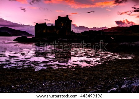 Eilean Donan Castle at evening, Dornie, Kyle of Lochalsh in Scotland, United Kingdom. It is the most visited castle, situated on an island at the confluence of three sea lochs. - stock photo