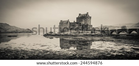 Eilean Donan castle at low tide at dusk in Scotland, UK.  - stock photo